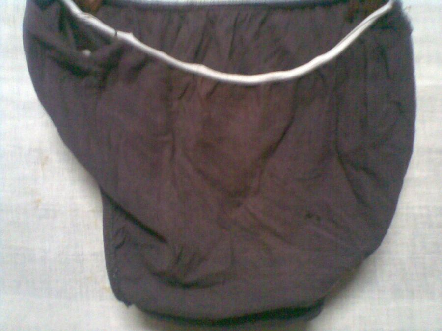 Old brown panty with holes back